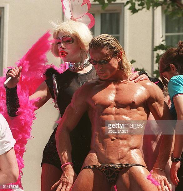 A male stripper performs durinmg the European Gay Pride march in Paris 20 June Around 100000 people took part in the annual event with organizers...