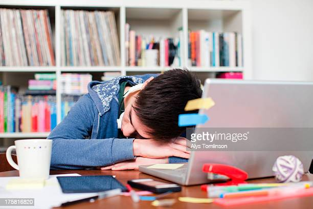 Male student asleep at desk