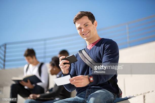 Male Student Depositing Check Through Smart Phone