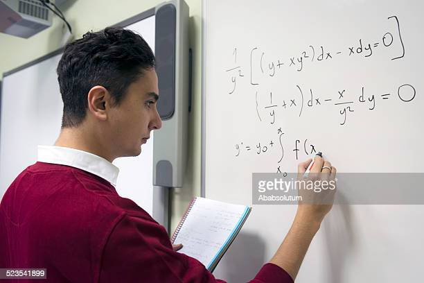 Male Student Doing Math at Secondary School, University inIstanbul, Turkey