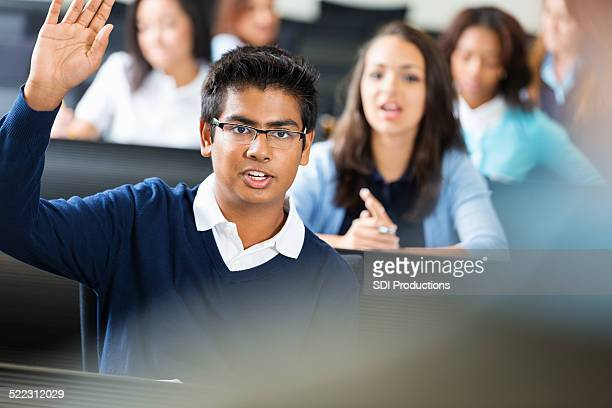 male student eager to answer a question in class - indian college girls stockfoto's en -beelden