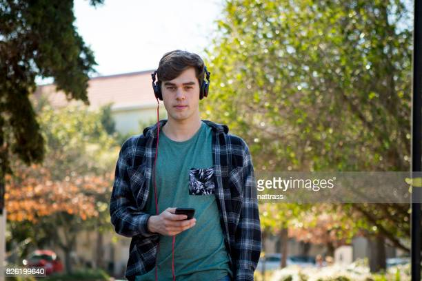 Male student listening to a music on the go