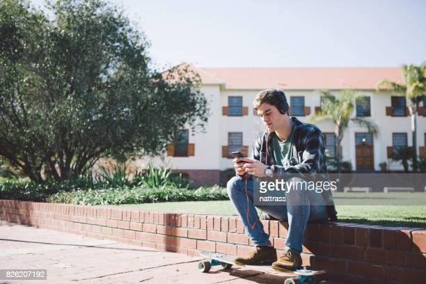 Male student listening to a podcast