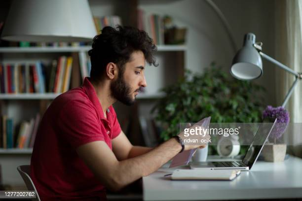 male student open postal letter from college committee - message stock pictures, royalty-free photos & images