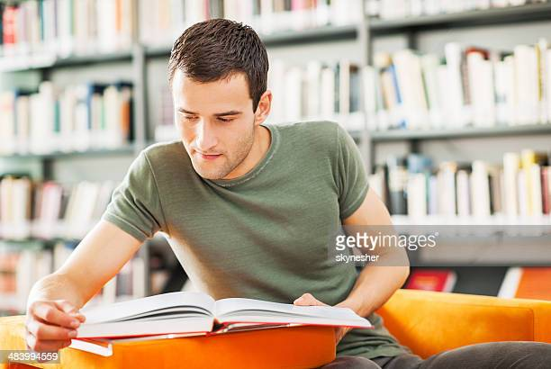 Male student studying in the library.