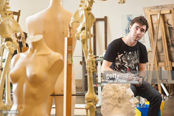 male student studying mannequins in studio - male likeness stock pictures, royalty-free photos & images