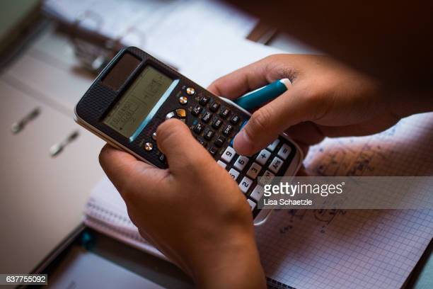 Male student using a calculator
