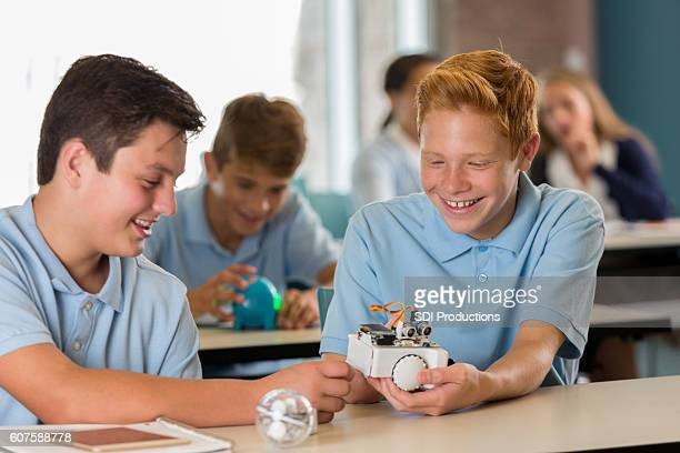 Male students working together on STEM robot