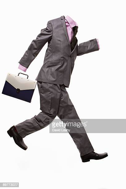 A male suit with briefcase, running