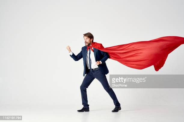 male superhero in a suit and red coat over white background - superhero stock pictures, royalty-free photos & images