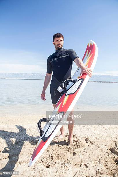 Male surfer on beach