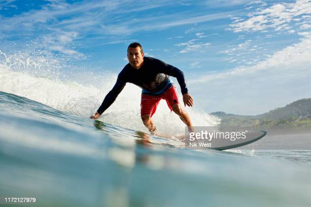 male surfer riding ocean wave - surf ストックフォトと画像