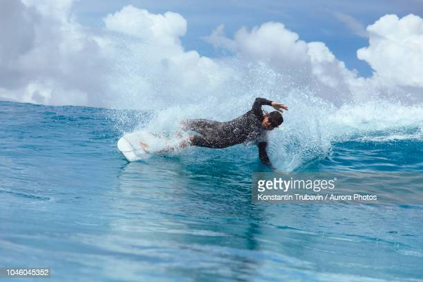 male surfer riding wave, male, maldives - male maldives stock pictures, royalty-free photos & images