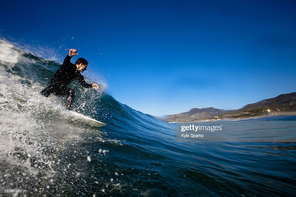 A Male Surfer Sets Up For A Backside Barrel While Surfing ... |Surfing Zuma