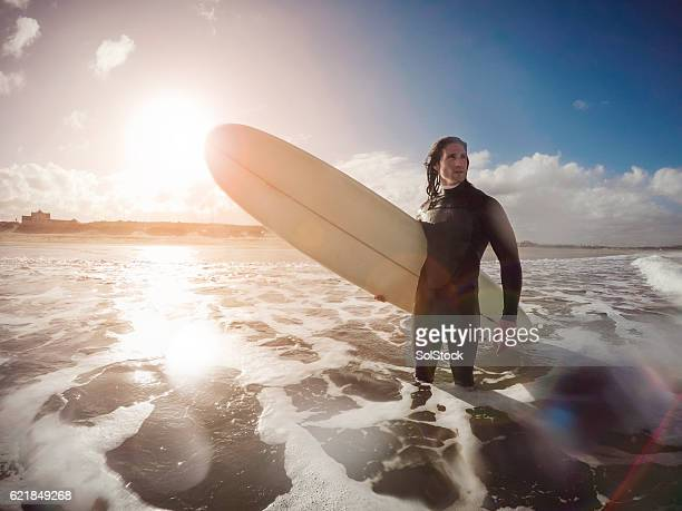 Male Surfer Standing in the Sea
