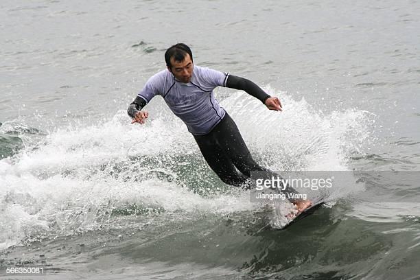 Male surfer surfing in Sagami Bay.