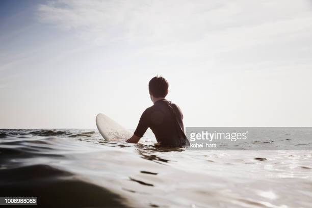 male surfer waiting for waves - waiting stock pictures, royalty-free photos & images