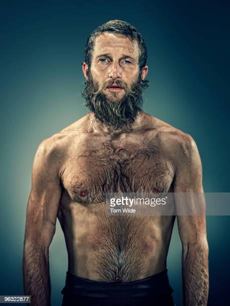 Male surfer with wet beard and hair