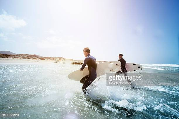 Male surfers on the beach
