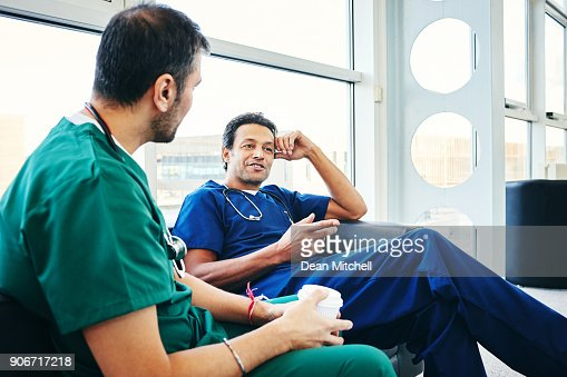Male surgeon in conversation with colleague