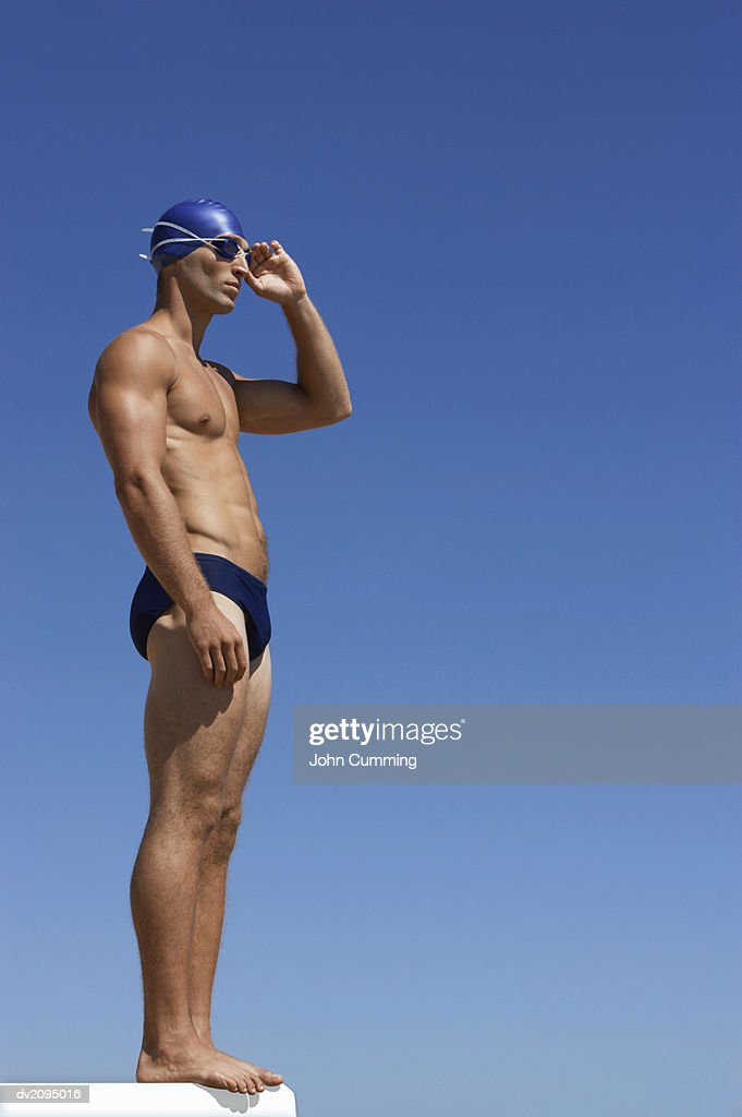 Male Swimmer Adjusting His Swimming Goggles : Stock Photo
