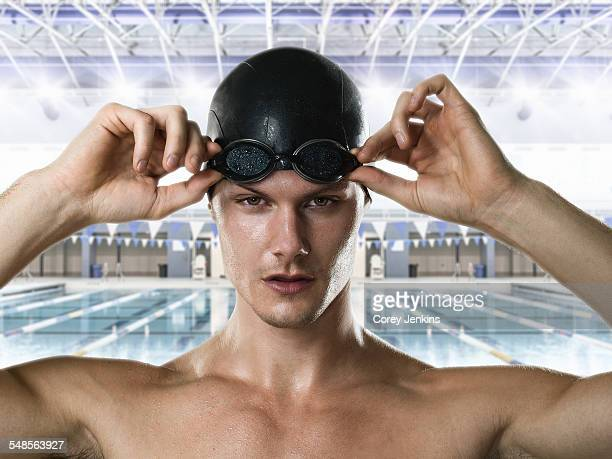 male swimmer adjusting swimming goggles - swimming goggles stock pictures, royalty-free photos & images