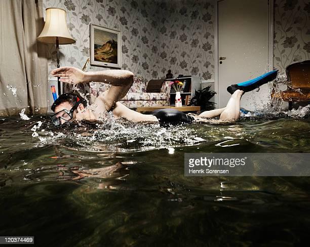 male swimmer in flooded living room