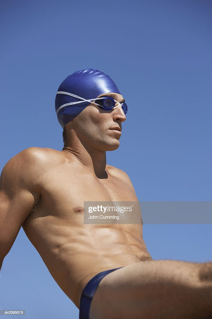 Male Swimmer Sitting Down : Stock Photo