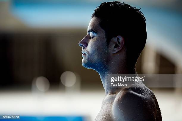 male swimmer with eyes closed