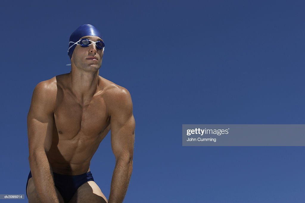 Male Swimmer With His Hands on His Knees : Stock Photo