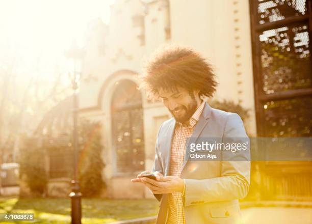 Male Talking on Smart Phone outdoors