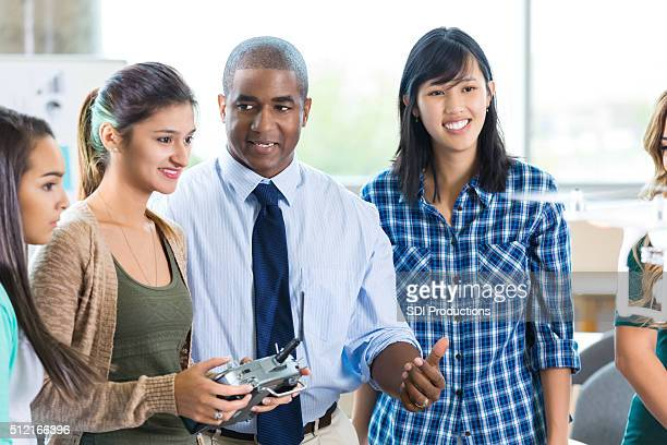 male teacher advises student in stem school - remote control helicopter stock photos and pictures