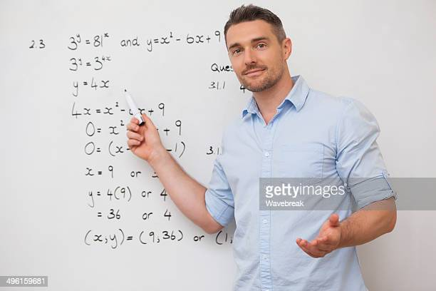 Male teacher at whiteboard in classroom