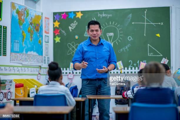Male Teacher Leading The Class
