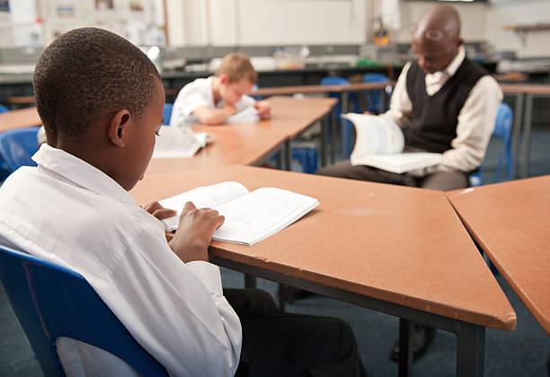 male teacher reading to boys in school classroom johannesburg gauteng picture id121528800?k=20&m=121528800&s=612x612&w=0&h=59LXwI 2jovAlwfymlt46d5e9byhP7S4 r38fObWT74=