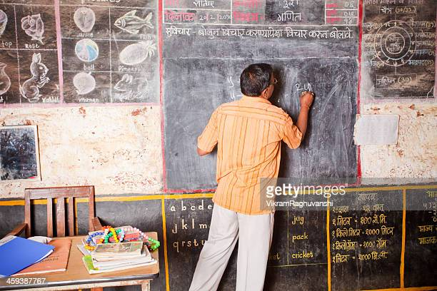 male teacher teaching in a rural school of india - teaching stock pictures, royalty-free photos & images