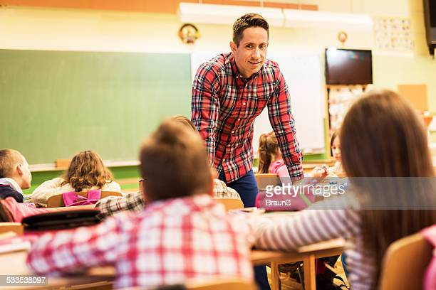 Male teacher teaching in the classroom.