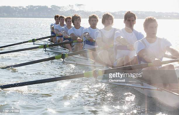 male team in a race of canoe - rowing stock pictures, royalty-free photos & images