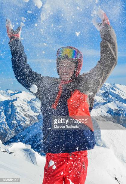 male teenager playing with snow - radicella stock pictures, royalty-free photos & images