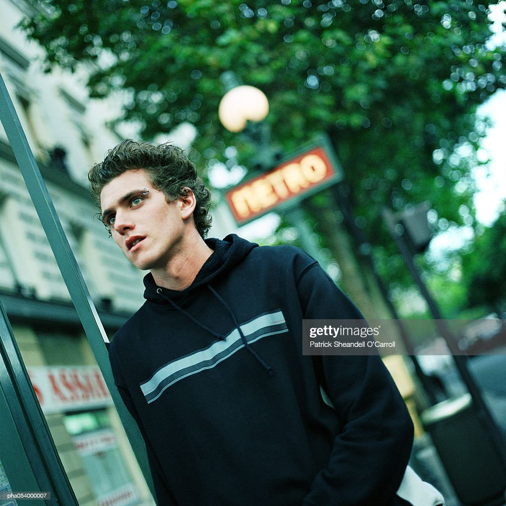 Male teenager under a blurred subway sign : Foto de stock