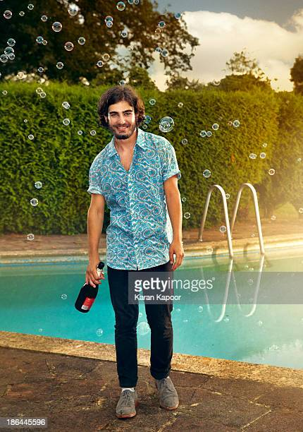 male teenager with champagne - short sleeved stock pictures, royalty-free photos & images