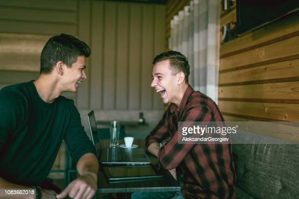 Male Teenagers Having Fun at Cafeteria