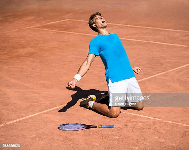 Male tennis player celebrating win