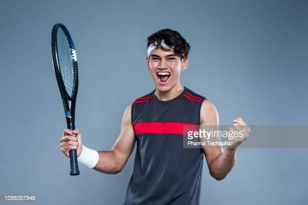 male tennis player celebration - テニスラケット ストックフォトと画像