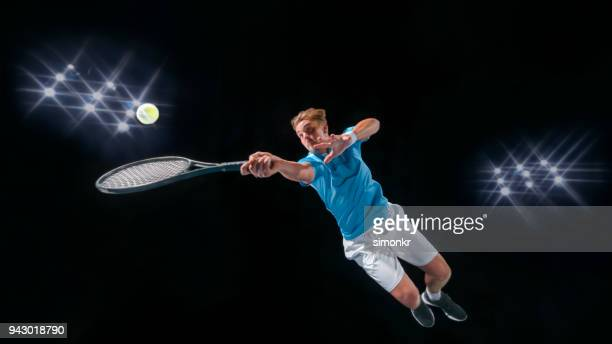 male tennis player hitting ball - tennis player stock pictures, royalty-free photos & images