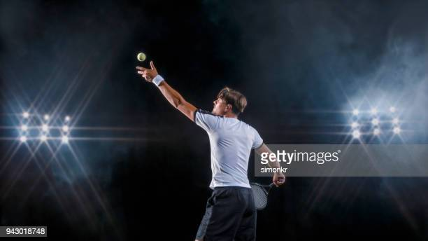 male tennis player serving - tennis player stock pictures, royalty-free photos & images