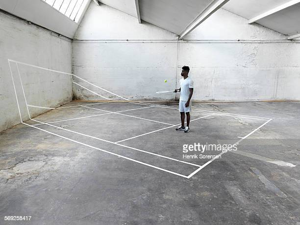 Male tennis player standing on tennis court