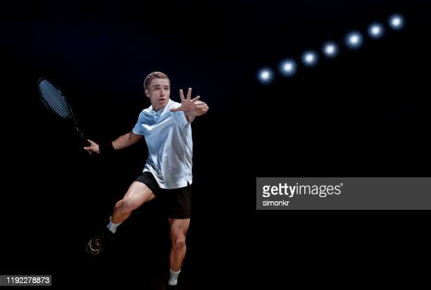 male tennis player waiting to hit ball - tennis player stock pictures, royalty-free photos & images