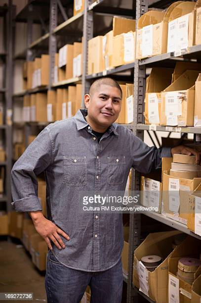 Male textile factory worker in storage room