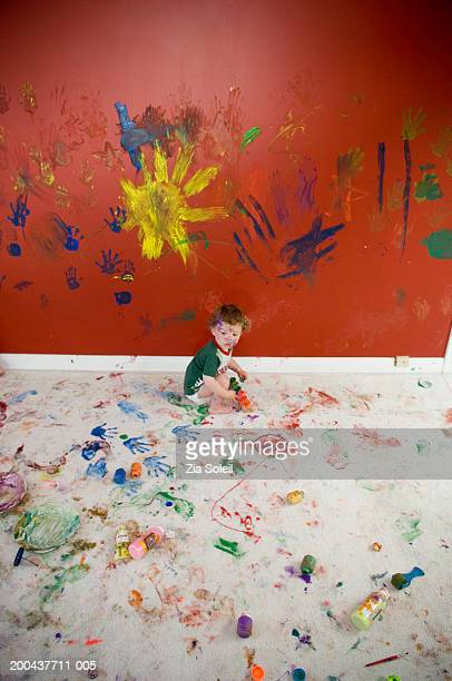 male toddler (12-15 months playing with paints, side view - chaos stock pictures, royalty-free photos & images